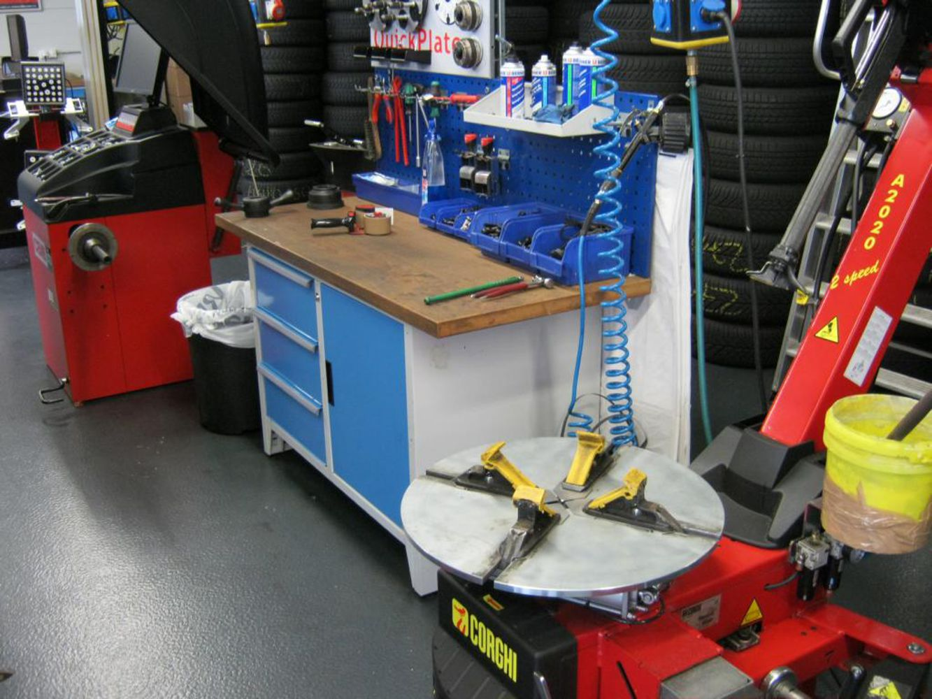 Workshop area with tyre changing machine